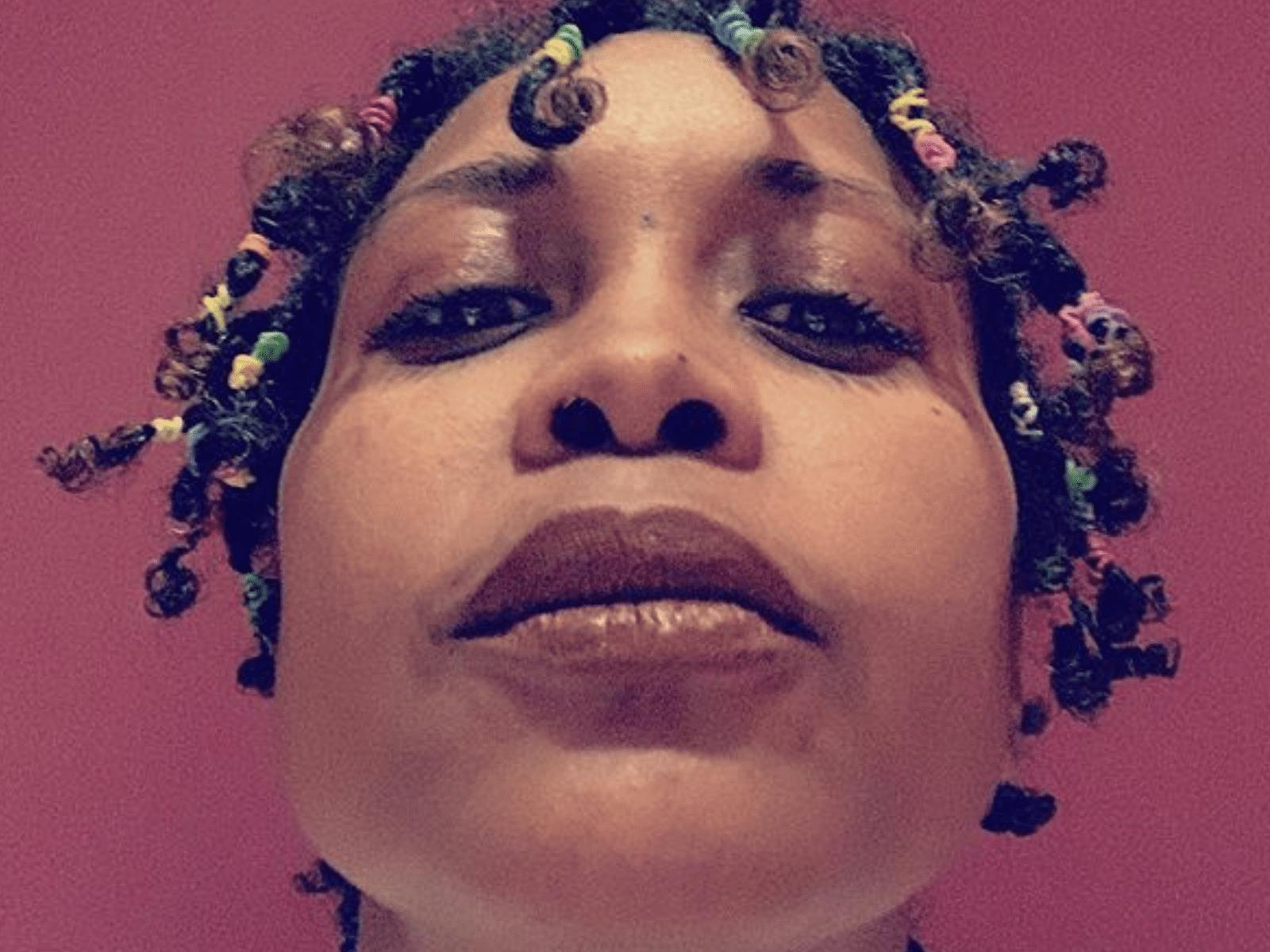 Erykah Badu Twists Hair