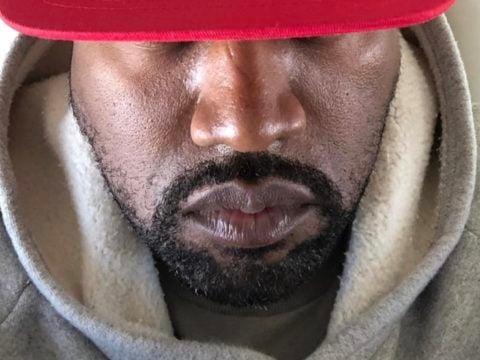 Kanye West wearing MAGA hat